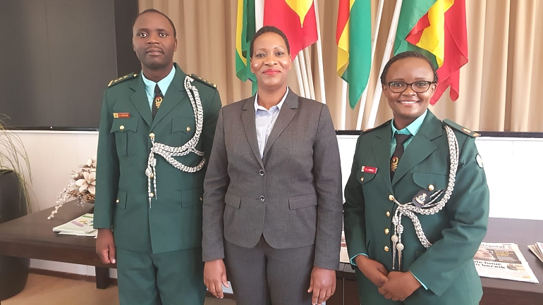 The Embassy's Head of Chancery Mrs. Naomi Zegezege Mpemba (Middle) with the two graduates, Captain Elia Joseph Lwenje (Left) and Major Veronica Henry Lyandala (Right)